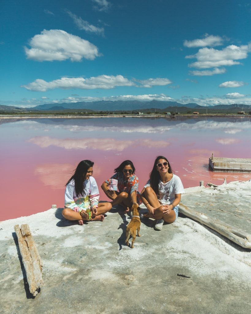 girls sitting on pink salt mine