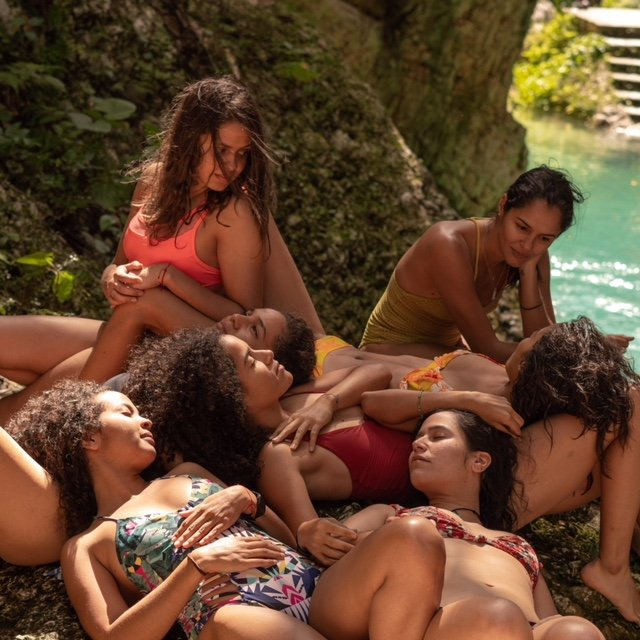 group of girls altogether in a river